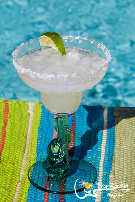 Margarita with lime and salt rim by the pool.