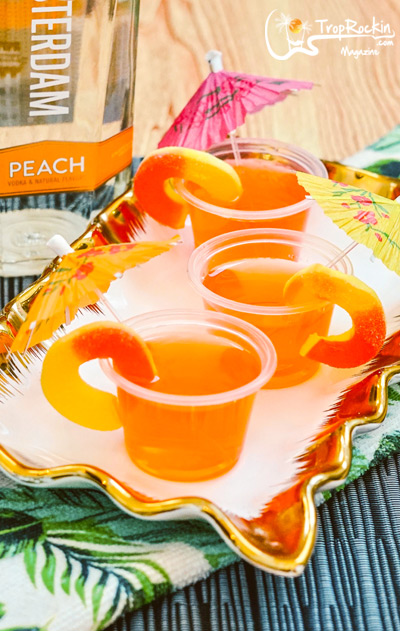 Peach vodka bottle and jello shots on serving platter