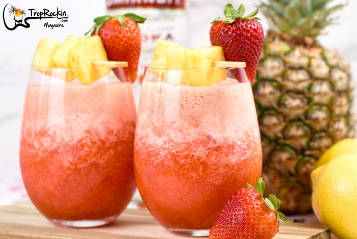 Two Glasses of Vodka Lemonade with Strawberries, Pineapple and Lemon