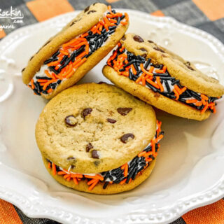 Three Stuffed Chocolate Chip Cookies with Orange and Black Sprinkles for Halloween displayed on white plate